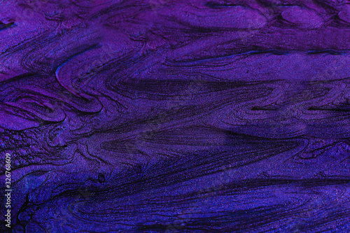 Beautiful stains of liquid nail polish,fluid art technique.Bright purple marble background. - 326768609