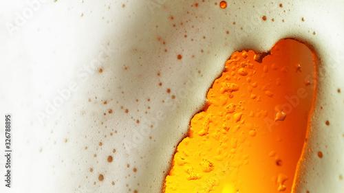 Fototapeta Detail of beer drink with overflowing foam head obraz