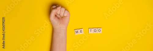 Fototapeta MeToo on wooden alphabet, used for concept of sexual harrassment. Woman fist as protest in shot obraz