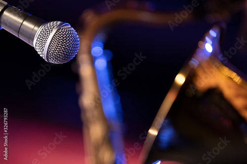 A microphone pointed at the bell of a baritone saxophone Canvas Print
