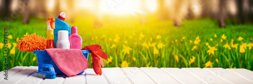 Fototapeta Cleaning supplies and chemicals on nature background web banner: spring cleaning concept obraz