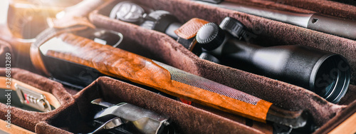 Fotografía Hunting rifle unfolded or demounted in modern case banner or panorama photo