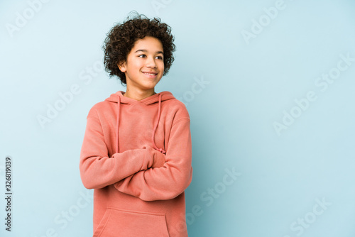 Obraz African american little boy isolated smiling confident with crossed arms. - fototapety do salonu