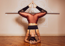 Young Beautiful Yoga Woman Is Posing In Studio On Mandala Background