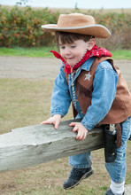 Toddler Dressed As A Cowboy Si...