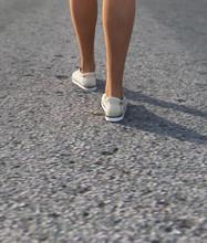 Close Up Legs Of Woman Walking On Street,3d Rendering