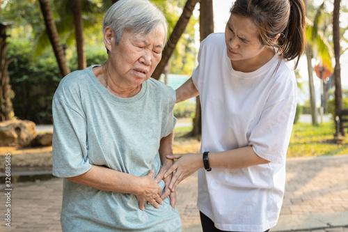 Valokuvatapetti Sick asian senior woman with belly pain,elderly have severe stomach ache,left si