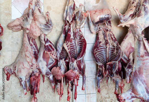 Photo Slaughter house with appliance and slaughtering animal.