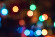 abstract Red glitter lights background. defocused. Colorful light bulbs and vivid round bokeh lights tree festive mood lightning