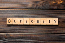 Curiosity Word Written On Wood...
