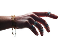 Female Hand Of Boho Style With Silver Rings With Turquoise Stone And Bracelets On A White Background. Hand Jewelry Bijouterie