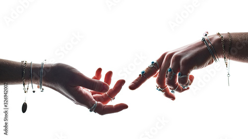 Foto Hands of a witch fortune teller sorcerer wearing silver rings with turquoise sto