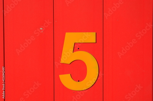 BRIGHT AND COLOURFUL NUMBERS ON WOODEN DOORS OF BEACH HUTS AT TRADITIONAL BRITIS Wallpaper Mural