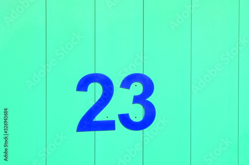 BRIGHT AND COLOURFUL NUMBERS ON WOODEN DOORS OF BEACH HUTS AT TRADITIONAL BRITIS Canvas Print