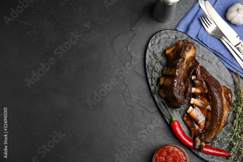 Delicious roasted ribs served on black table, flat lay Canvas Print