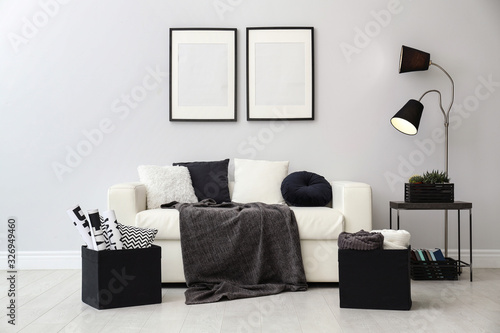 Fototapeta Elegant white sofa in modern living room interior obraz