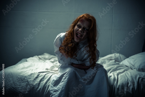 obsessed creepy girl in nightgown shouting in bedroom Canvas-taulu
