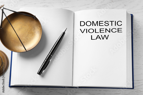 Domestic violence law and scales of justice on white wooden table, above view Canvas Print