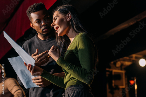Canvas multiethnic actor and actress having rehearse on stage in theater