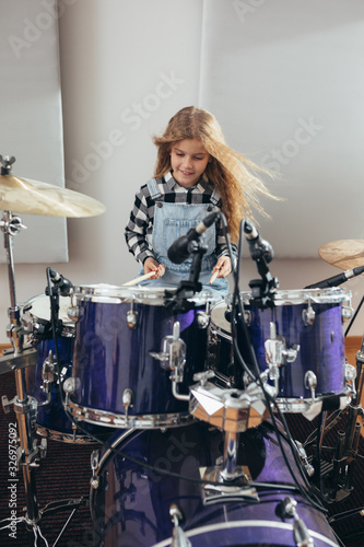young girl playing drums at the music studio Poster Mural XXL