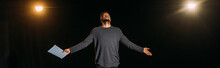 Panoramic Shot Of African American Actor Holding Scenario And Standing On Stage During Rehearse