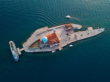 Aerial View Of Our Lady Of The Rocks Is One Of The Two Islets Off The Coast Of Perast In Bay Of Kotor, Montenegro. 09-05-2019. Roman Catholic Church