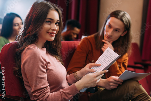 Fototapeta handsome actor and beautiful actress reading scripts in theatre