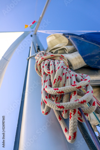 Photo Rope Hank Hangs on the Mast of a Sailing Yacht and Blue Sky