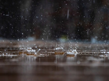 Raindrops On Surface Of Deck
