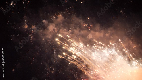 White and red fireworks display on dark sky background Wallpaper Mural