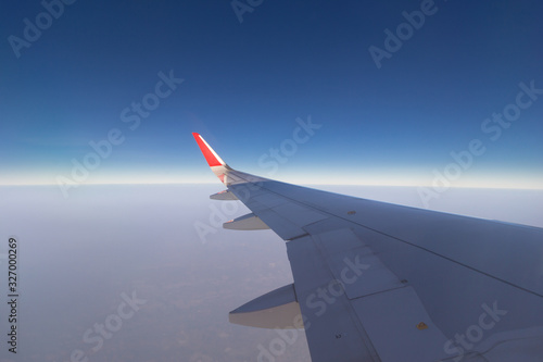 View of Sky from airplane window Wallpaper Mural