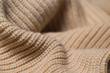 Knitted Fabric Wool Texture Close Up As A Background.