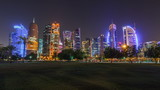 The skyline of Doha by night with starry sky seen from Park timelapse , Qatar