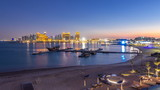 View from Katara Beach day to night timelapse in Doha, Qatar, towards the West Bay and city center