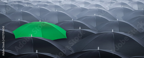 Different and standing out of the crowd umbrella. Concept of leader. - 327014656