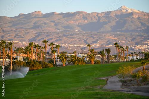 Fototapeta Watering on evergreen grass field on large golf course on Tenerife island, Canary, Spain obraz