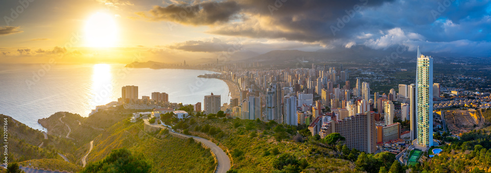 Fototapeta Breathtaking aerial panoramic view of summer resort with beach and famous skyscrapers. Beautiful sunset over city. Costa Blanca. City of Benidorm, Alicante, Valencia, Spain.