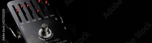 Guitar pedal equalizer on black horizontal background Fototapeta