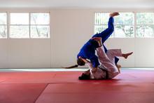 Judokas Practicing Judo During...