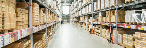 Fotografiet Panorama of Rows of shelves with boxes in modern warehouse