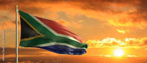 Cuadros en Lienzo South Africa flag waving on sunset sky background