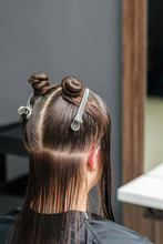 Dividing Woman's Hair In Sections With Clips During Hair Extension In Beauty Salon.