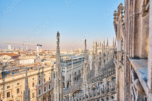 Amazing view of old Gothic spires. Milan Cathedral roof on sunny day, Italy. Milan Cathedral or Duomo di Milano is top tourist attraction of Milan.