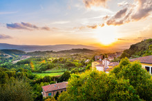 Colorful Evening Sunset In Small Town Of Chiusi, Tuscany Italy With Houses Roof Rooftops On Mountain Countryside Rolling Hills Landscape And Picturesque Cityscape With Sun
