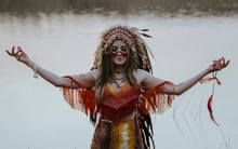 A Girl Dressed As A Native Ame...