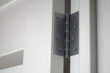 Metal Door Hinges Close-up. Interior Door With Glass Inserts
