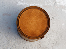 A Rusty Can Of Paint On Concre...