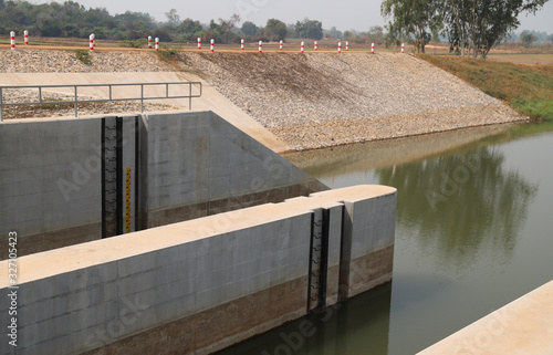 Closeup of a part of concrete dam and water level  measuring tool Canvas Print