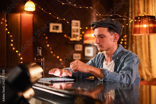 people and technology concept - happy man with smartphone drinking beer and read Wallpaper Mural