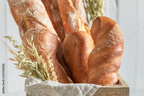 Closeup of homemade french baguettes in wooden box Canvas Print